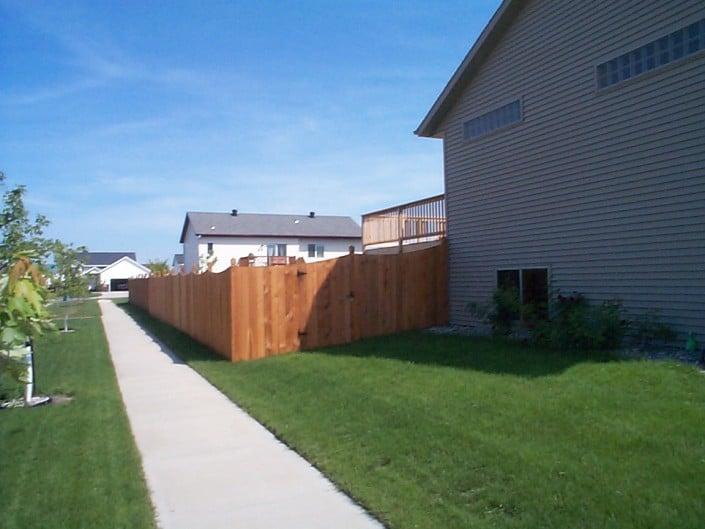 fence along a sidewalk