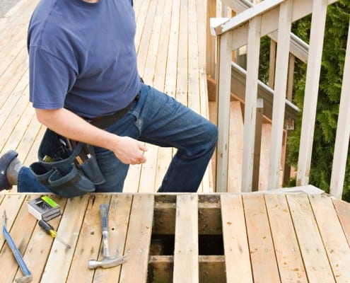 picture of a deck builder constructing a deck