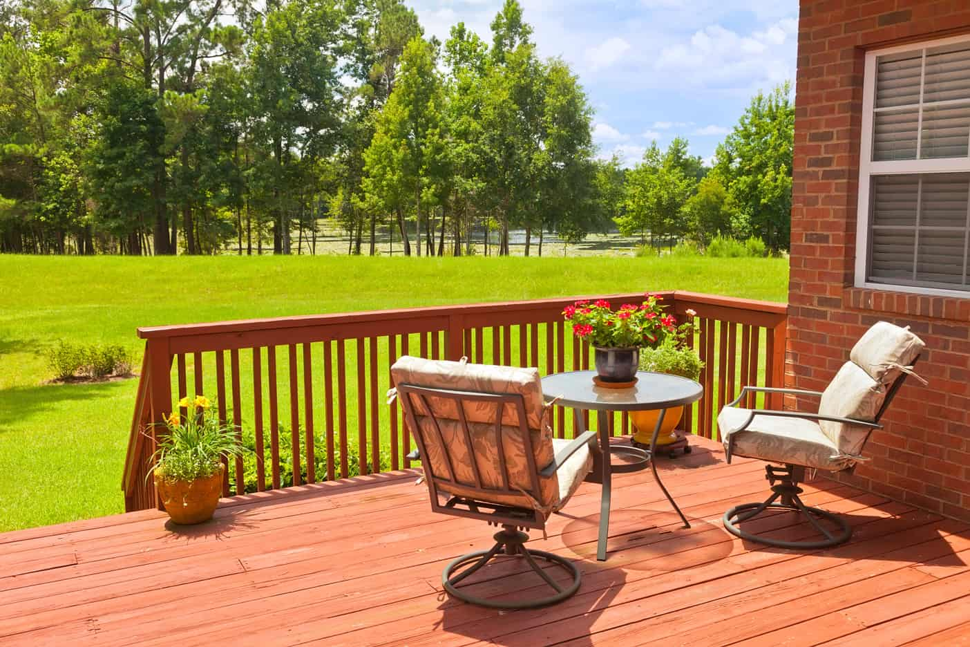 redwood deck in backyard : Liberty Fence and Deck