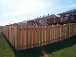 fence with spaces between slats