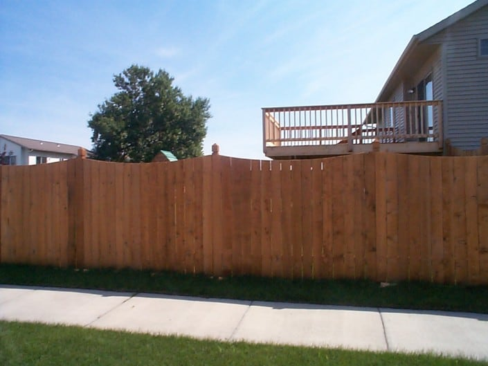 fence with deck in background